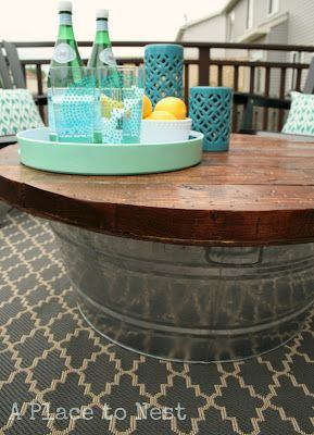 This is a genius idea. you can store all the stuff in the table that you don't want to leave out in case it rains (citronella candles, pillows, etc.), then just grab it out whenever.  Outdoor Coffee Table/Storage | remodelaholic.com #patiofurniture #diy #bucket @Remodelaholic .com .com .com .com