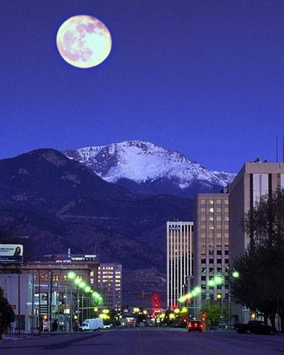 Colorado Springs & Pikes Peak: a mountain in the Front Range of the Rocky Mountains within Pike National Forest west of CO Springs; easternmost fourteen thousand foot peak in the US; composed of a characteristic pink granite called Pikes Peak granite due to potassium feldspar