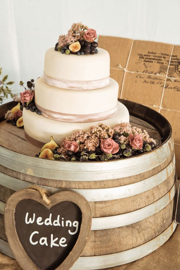 What a great way to display a cake, but on a gorgeous oak barrel!  Also loving the natural fruit topper!  Photograph by Truly Madly Photographers http://www.storyboardwedding.com/australian-country-farm-wedding-featuring-a-private-tasmania-farm-complete-with-shabby-chic-touches/