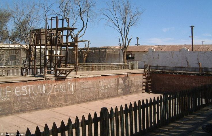 An abandoned swimming pool, daubed with graffiti, rusts away in Humberstone