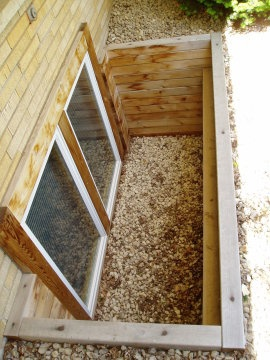 Egress window well idea - simple! ...space the step out a bit to allow for planting room and it'd be perfect!