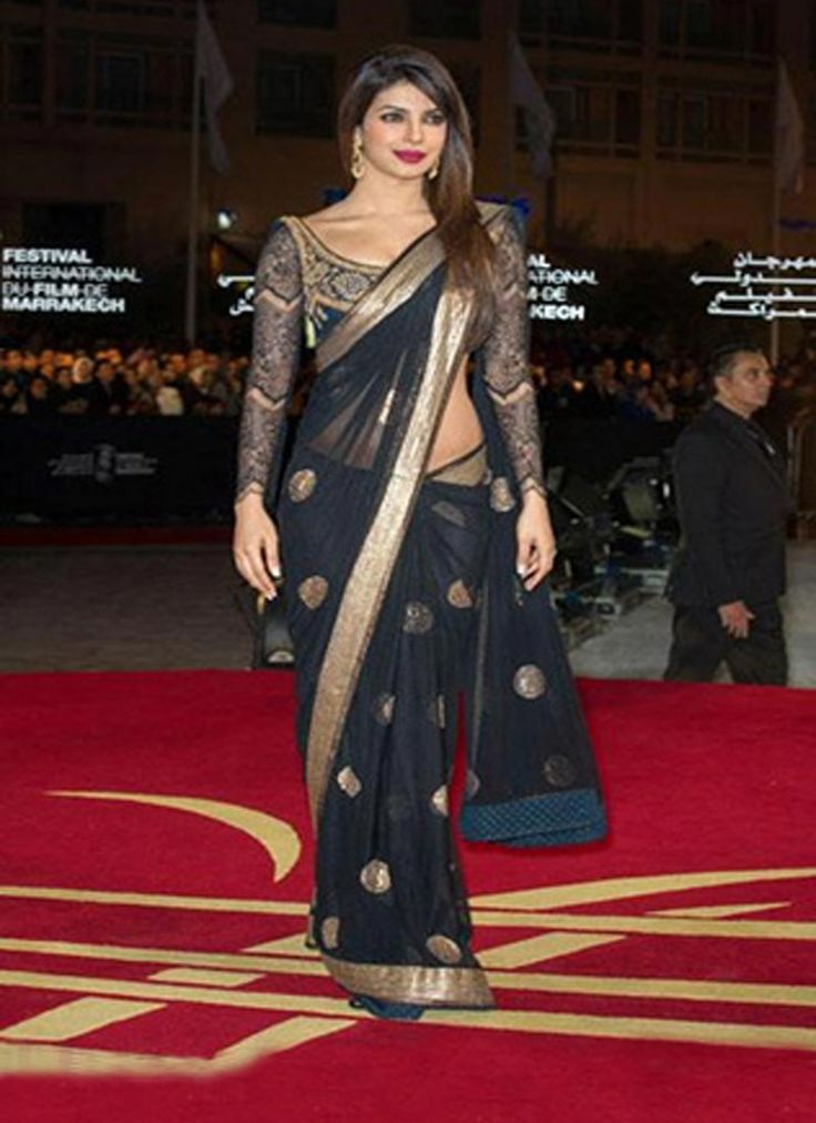 Priyanka Chopra Black Patch Border And Sequins Work Net Bollywood Saree, Product Code :7392, shop now http://www.sareesaga.com/priyanka-chopra-black-patch-border-and-sequins-work-net-bollywood-saree-7392  Email :support@sareesaga.com What's App or Call : +91-9825192886