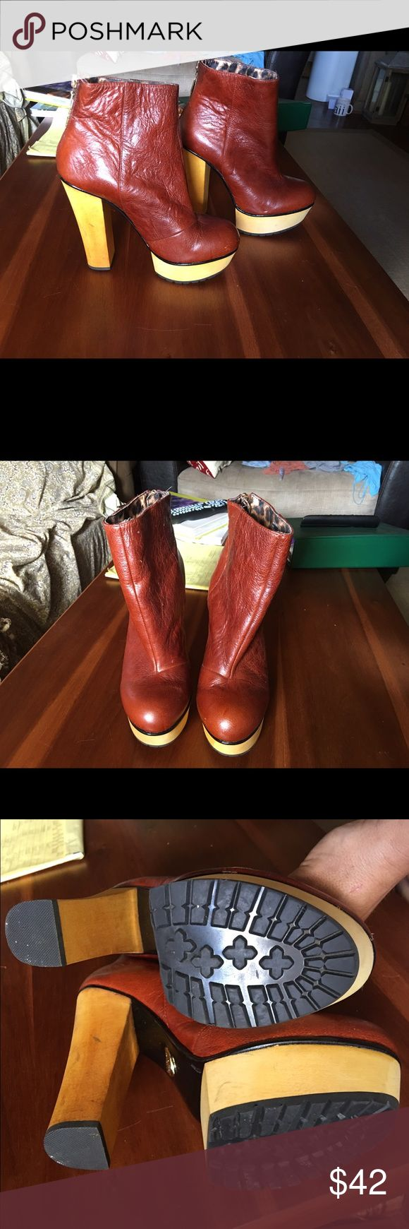 Betsey Johnson platforms. Size 8. Like new Like new. Never worn. Cinnamon leather colored Betsey Johnson platform heels. Size 8, lightning bolt zipper pulls on rear ankle.  Leather upper wooden lower Betsey Johnson Shoes Ankle Boots & Booties