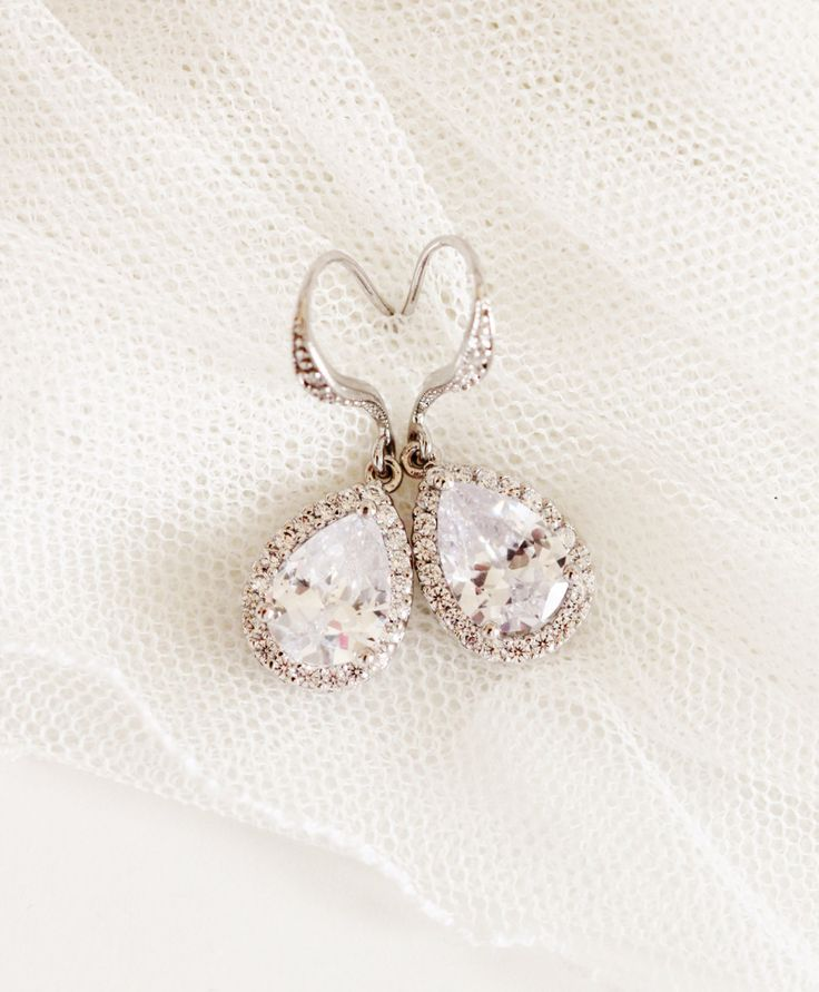 Gorgeous Crystal Bridal Earrings Silver Drop Earrings Wedding Jewelry Bridesmaid gift Teardrop CZ Earrings Bridesmaid Earrings Bridal Jewelry Bridal Party Gifts  Made with: * Luxury clear white(16mmx11mm) teardrop Cubic Zirconia setting in rhodium plated brass frame, tiny cubic zirconia crystals al