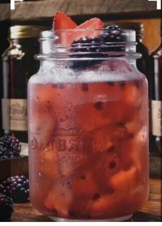 Huckleberry Hooch Shake & Pour 1.25 oz Ole Smoky Blackberry Moonshine .5 oz Monin Huckleberry 1 oz Cranberry Juice .5 oz Orange Juice .5 oz Pineapple Juice 2 Blackberries 2 Strawberry slices Top with soda water  If Batched, 3.75 oz of mix  Mason Jar, 2 blackberry and 2 strawberries