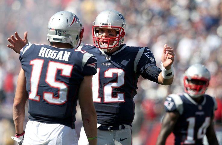 Foxborough, MA 09/24/17 Patriots quarterback Tom Brady congratulated Chris Hogan after he made a touchdown in the second quarter. The England Patriots host the Houston Texans Sunday, Sept. 24, 2017 at Gillette Stadium. (Jim Davis/Globe Staff)