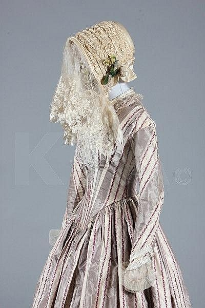 A fine striped taffeta bridal gown and bonnet, circa 1845, of grey and ivory silk with wine foliate stripes via Kerry Taylor Auctions.