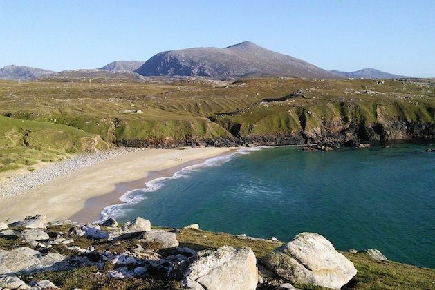 Wigwam Holidays: Mangersta Beach is a short walk from our Shepherd's Hut and Wigwams. 'Mealaisbhal' the highest hill on the Isle of Lewis, rises behind the beach. A climb to the summit gives panoramic views of the Harris hills and out across the North Atlantic Ocean to The Flannan Isles and St Kilda.