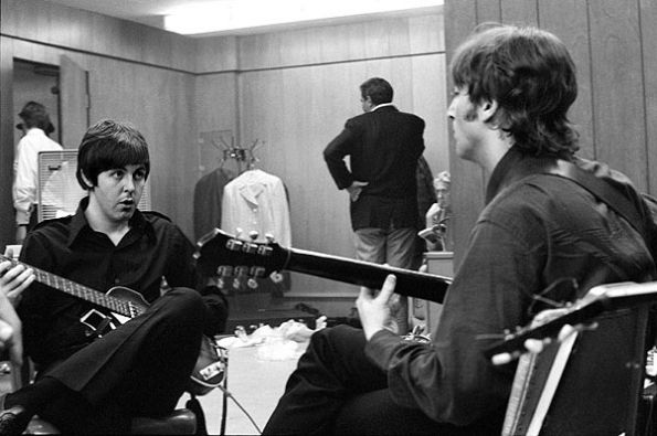 Paul McCartney and John Lennon warming up backstage in Detroit on August 13, 1966.