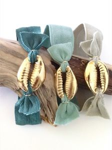 Mai Tie - hand dyed satin elastic wrist/hair band in new Fall 2012 colors and natural ombre with an 18k gold cowrie shell