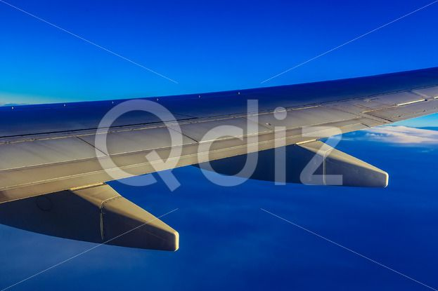Qdiz Stock Photos Plane Wing above Sky and Clouds