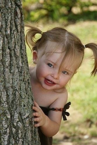 Children like her just love to play in the garden! All the more reason to pretty up the garden :)