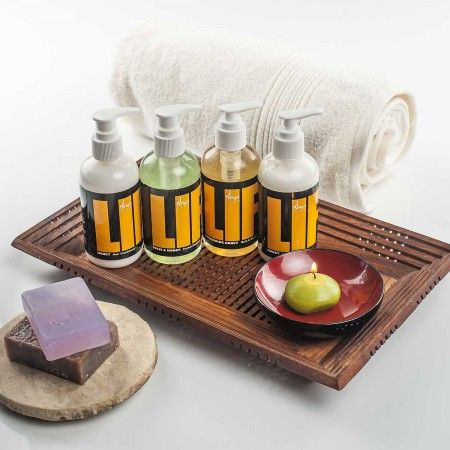 Bath set featuring shampoo, conditioner, lotion & handmade soaps with organic honey for a pampering gift basket.