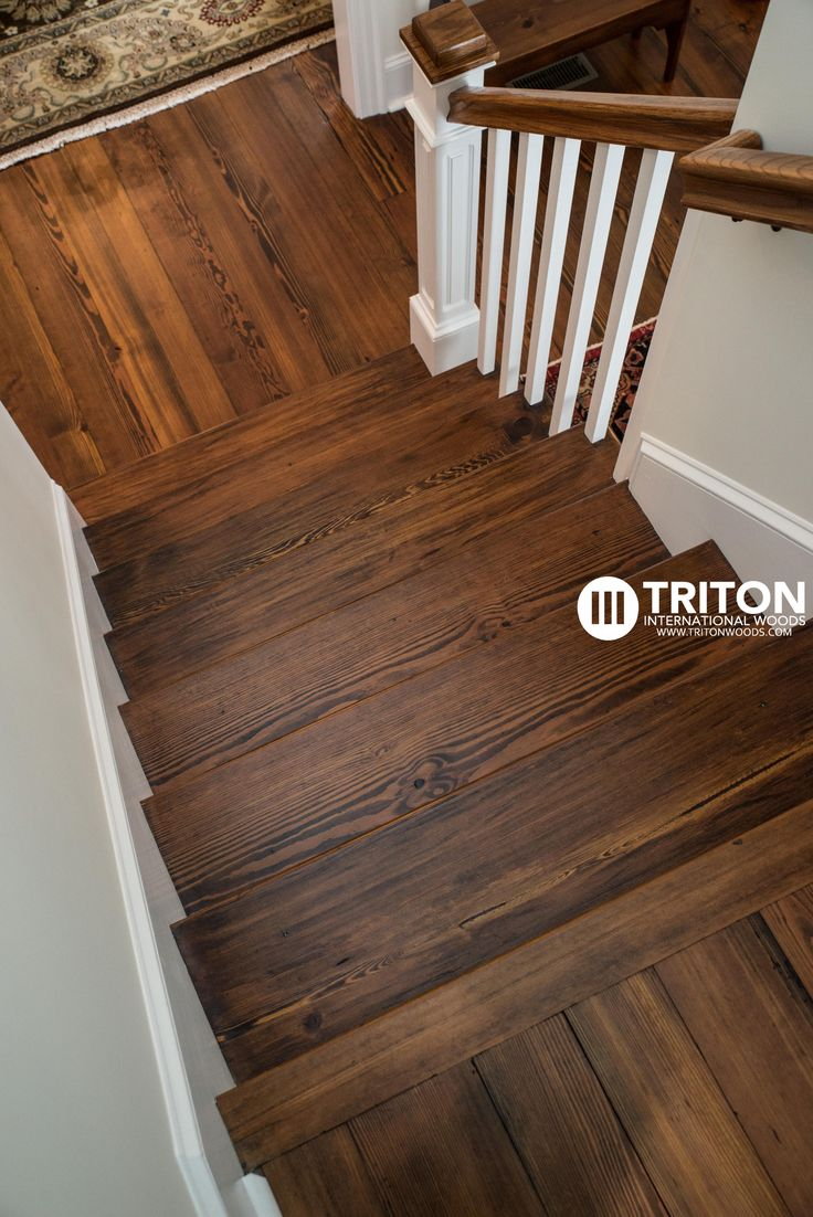 """""""Old Original"""" Antique Heart Pine flooring. Also produced, installed, and finished the stair treads and hand rails shown."""