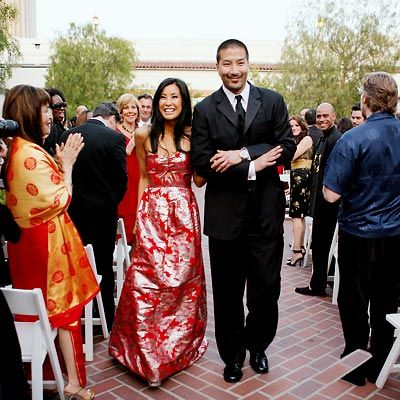 """Celebrity Wedding: Lisa Ling & Paul Song  The invitation provided the first hint that the wedding of Lisa Ling, 34, and Paul Song, 42, would be like no other. """"If you're cool,"""" it read, """"you'll dress Asian chic."""" Indeed, the ushers sported Cobra Kai uniforms à la The Karate Kid; the groom, oncologist Paul Song, changed into Converse Chuck Taylors and a traditional Korean hanbok for the reception; and his bride was ravishing in ... red!"""