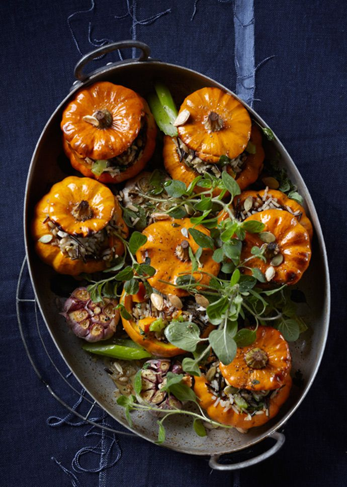 Who said Thanksgiving pumpkins had to sweet - or that you need meat for a great thanksgiving meal? Baked- wild rice stuffed mini pumpkins A beautiful #VegetarianThanksgiving treat!