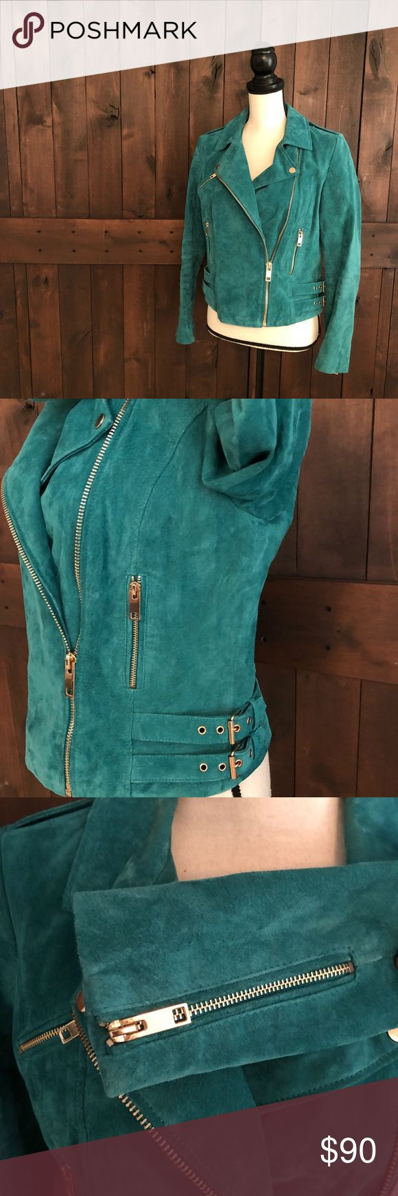 "MANGO Teal Leather Moto Jacket Excellent condition, lightly worn twice and well cared for, 100% pork leather exterior (feels somewhat like suede), fully lined 100% poly, pale gold hardware, zippers at hips, chest and center, snaps at shoulder, double buckles on sides, zippers on sleeves.  Sleeve: 23"" Chest: 18"" flat Length: 21.5"" Mango Jackets & Coats"