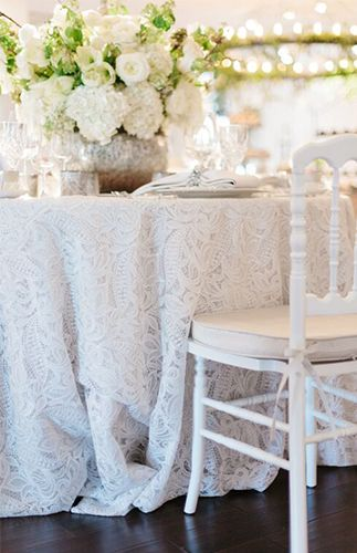 Lace tablecloths and white on white. Painted it limewashed chairs for a classic look.