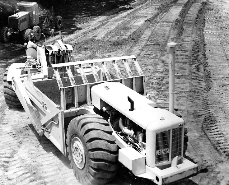 Newly delivered model 6UOT TS-14 of N.Z.Roadmakers on its first job at the site of what was to become Alcan Aluminium in Wiri, South Auckland, 1961. The 6UOT, first of the TS-14's, differed from all other TS-14's by having its rear aircleaner mounted off to the right as can be clearly seen. Note also the rear exhaust pipe with no muffler, standard equipment in the 1960s.