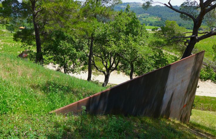 "Richard Serra ""Aix"" 2008 (Part B) There are three large plates of steel that intersect the landscape in such a manner to suggest a ""A"" however depending on your perspective to the hill you may only see two of these plates at any given time"