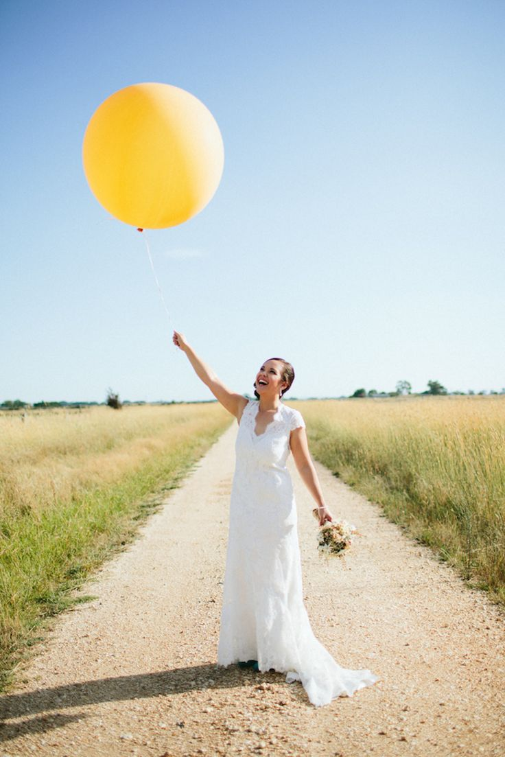 A yellow balloon makes a perfect accessory | Photography: Louise Buma - www.sunnyandscout.com  Read More: http://www.stylemepretty.com/australia-weddings/2014/09/29/country-diy-victoria-wedding/