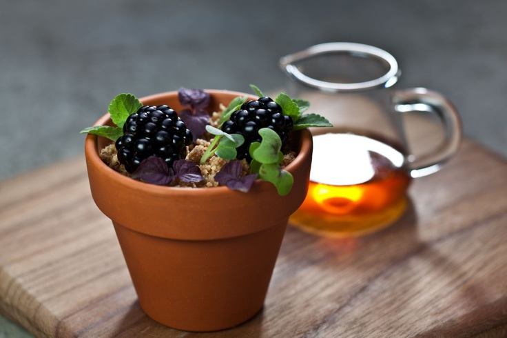 Sesame panna cotta with crumble, transfused with black tea sirup in an untraditional arrangement.