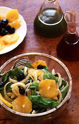 Sicilian Fennel Salad with Oranges, Arugula, and Black Olives - In Sicily, this salad is traditionally prepared with wild chicory, a slightly peppery, tender-leafed green. Substitute with arugula if you can't find wild chicory.