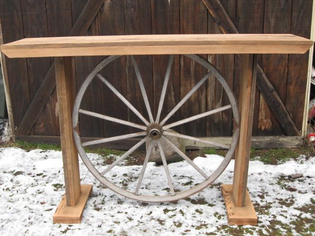 Custom couch table/hall table made with barnwood and an old wagon wheel.