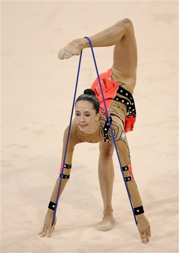 Israel's gymnast Neta Rivkin performs with the rope during the gymnastics rhythmic individual all-around qualification - Beijing Olympics 2008
