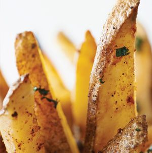 Don't even think about preheating the oven to make fries to go with burgers. Use the grill to make these Chipotle Fries. Adjust the amount of chipotle chili powder to suit your tastes.
