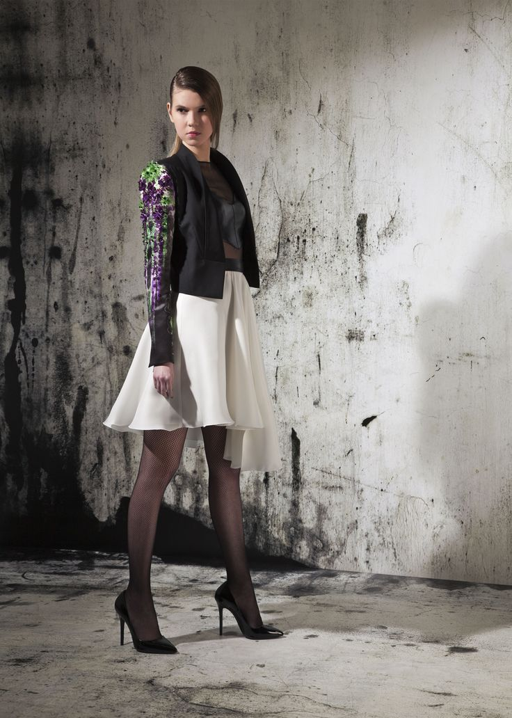Black twill jacket with black leather top and white silk skirt