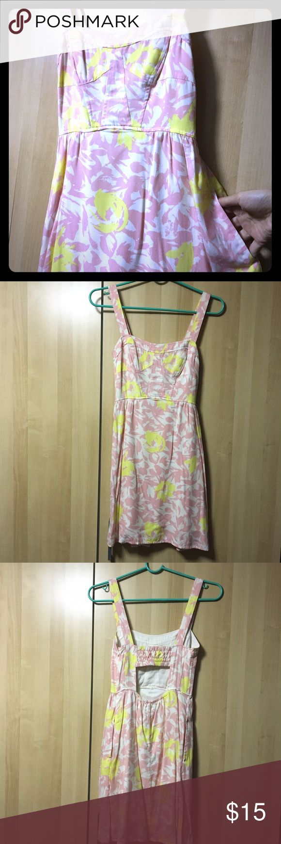 Black Poppy Sundress A cute & flirty sundress with a floral/petal pattern in pink, white & yellow, by Black Poppy from Pacsun. Fitted at top with cutout in back and stretchy, lightweight comfortable material two layers at bottom. Two side pockets, really convenient and adorable. Lightly worn, excellent condition. Questions welcomed Black Poppy Dresses Mini