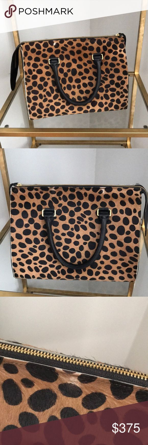 Clare V. Leopard Satchel Used leopard hair calf leather satchel. Inside is lined with denim canvas. Zipper pocket and 3 other open pockets. It can be worn 2 different ways as shown in pics. Please note there are 3 spots of wear on the hair calf that is from natural wear. All leather. There is no dust bag. Please be considerate when making offers. Clare Vivier Bags Satchels