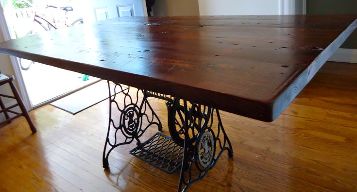 """Custom dining table made by yours truly...     2"""" reclaimed Hemlock Barn-board with a re-purposed antique singer cast iron sewing machine base... quite proud of this one I must say"""