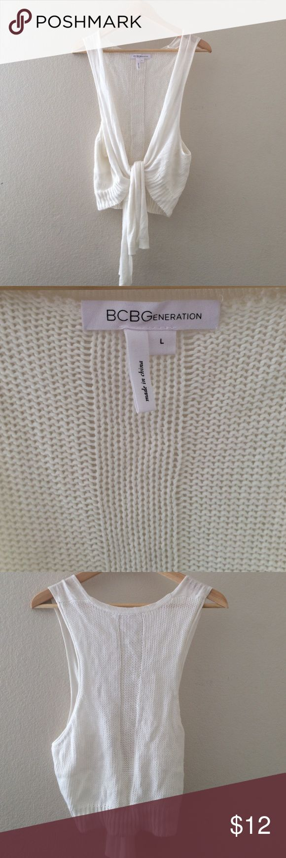 White BCBGeneration sleeveless sweater tie front. White BCBGeneration sleeveless tie front sweater.  Excellent condition.  Like new.  Super cute. BCBGeneration Tops