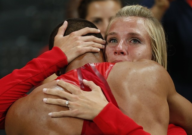 United States' Ashton Eaton is embraced by his fiancee Brianne Theisen after he won the decathlon during the athletics in the Olympic Stadium at the 2012 Summer Olympics, London, Thursday, Aug. 9, 2012. (AP Photo/Matt Dunham)