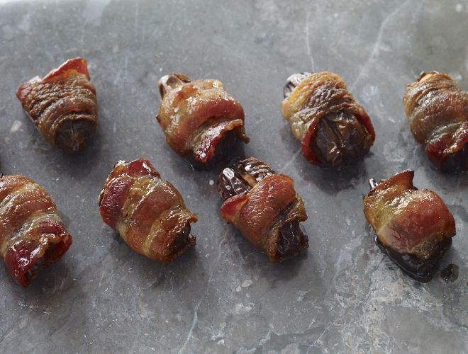 A different and intriguing recipe these almond stuffed dates wrapped in bacon are quite addictive.