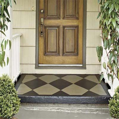 Paint front stoop: map the design with painter's tape and use a roller brush to apply latex porch and floor paint.