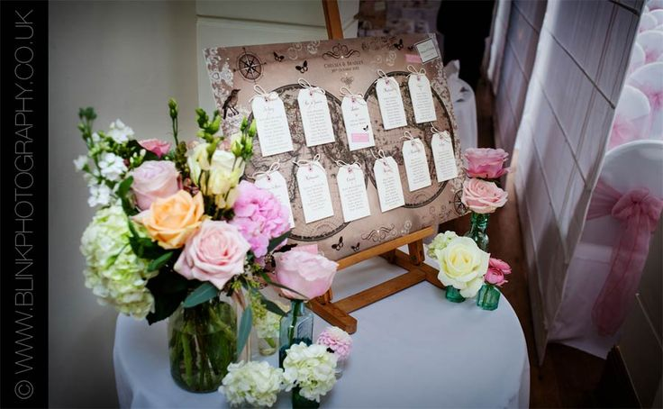Pembroke Lodge Wedding Table Planner with flowers by Fairy Nuff Flowers