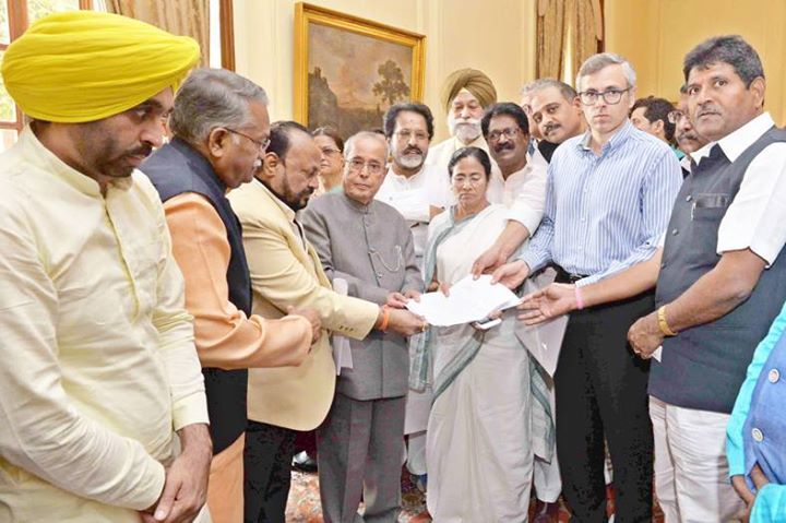 A delegation of MPs and leaders from different political parties led by West Bengal Chief Minister Mamata Banerjee National Conference leader Omar Abdullah meeting President Pranab Mukherjee at Rashtrapati Bhavan in New Delhi. (UNI)