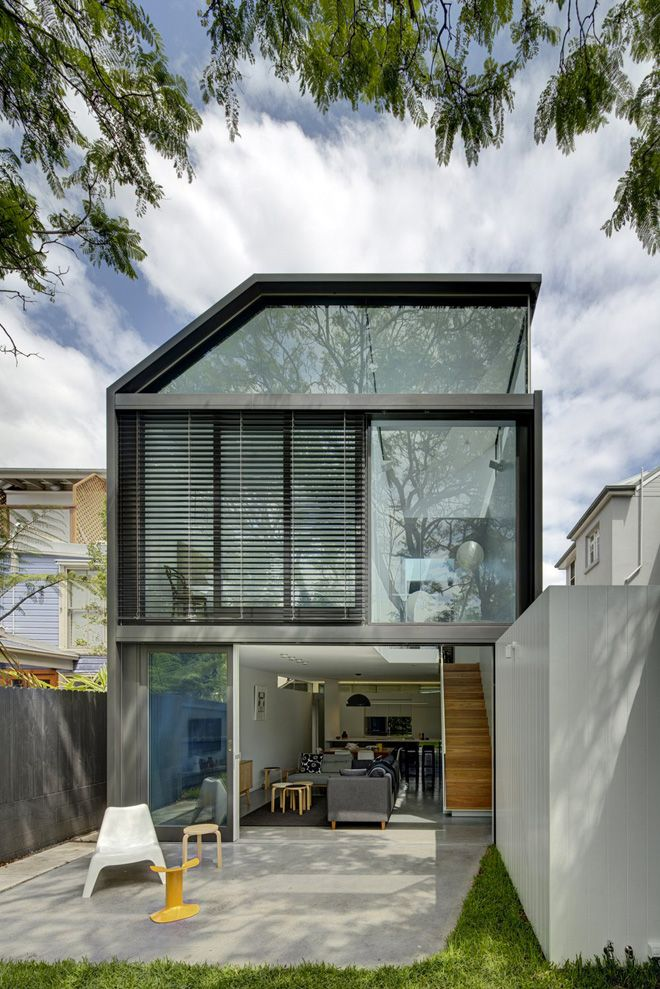 Australian architect Christopher Polly has converted a small Australian bungalow into a two-story dwelling in the Sydney suburb of Annandale.