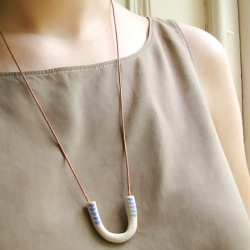 I love the beautiful, simple look of ceramic jewelry (by Cla Contemporary via Epheriell Designs)