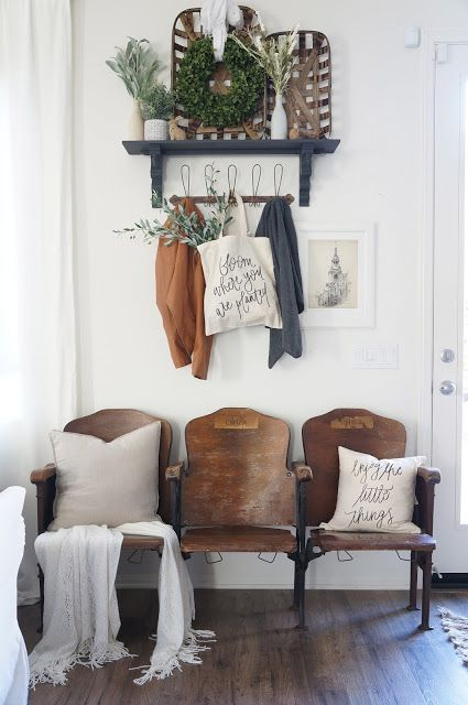 Vintage 1920's theater seats in the entryway! And her story of how she found them is just perfect. I can so relate!