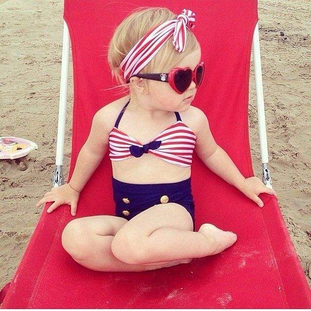 Super cute- pinup looking bathing suit for toddler girl. Stripes, navy blue, gold buttons, headwrap sunglasses