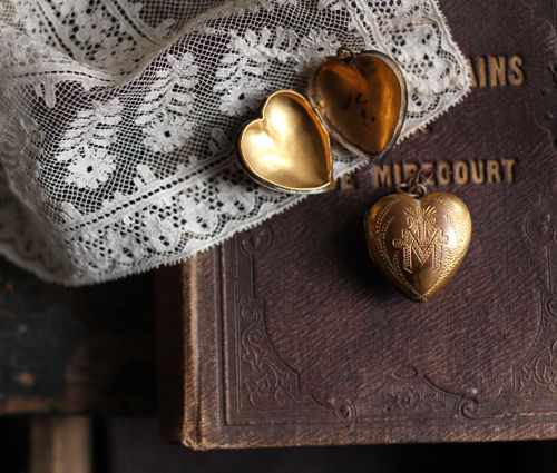 Old book and old heart locket