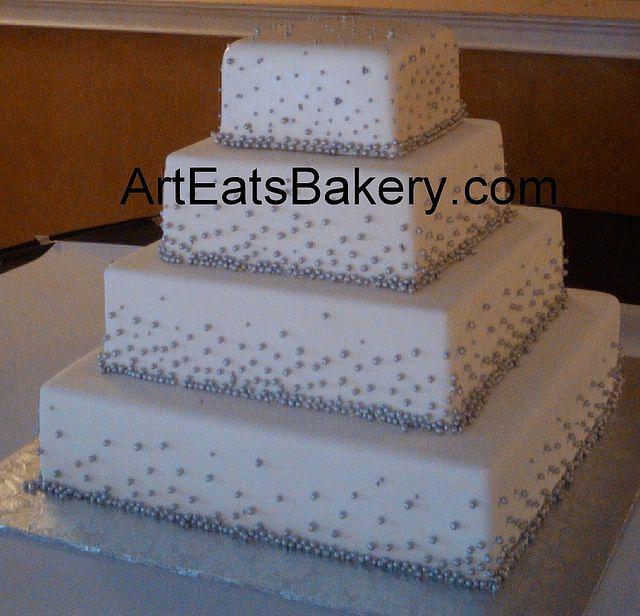 Four tier square white fondant unique custom wedding cake with silver sugar pearl design, via Flickr.