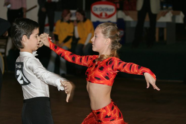 Young couple dancing cha-cha-cha at a junior Latin dance competition in the Czech Republic.