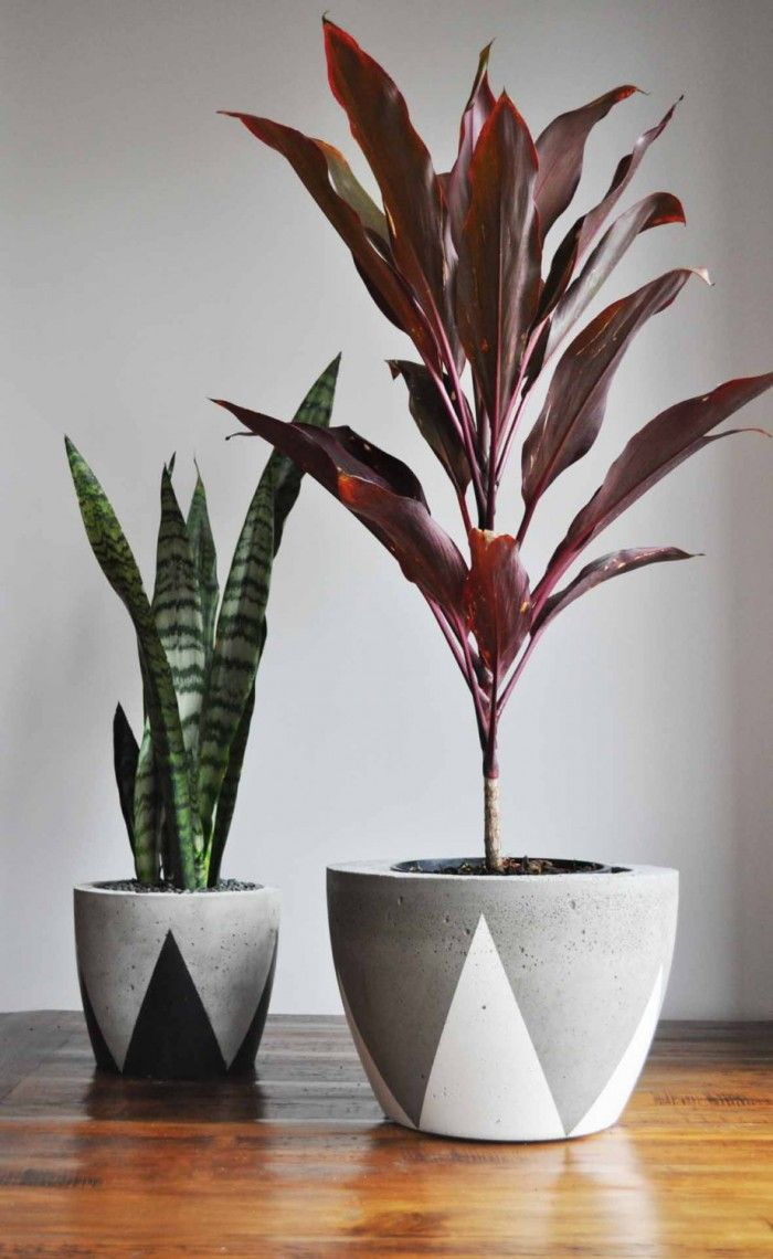 grey and black painted pots