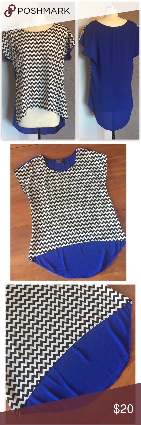 """MMMM Couture Chevron High-Low Top Chevron Top by MMMM Couture Short cap sleeves . Light weight. Chevron front black/white -  solid blue back  Size: Large. Worn a few times but in great condition. Length: High/ low 24"""" - 31"""" //  Bust: 21"""" MM Couture Swim"""