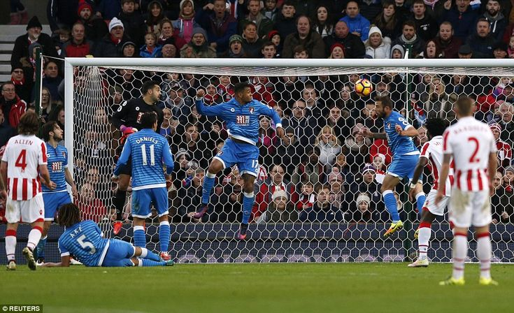 Stoke almost equalised through a Shawcross header, but Steve Cook (third right) cleared the ball off the line